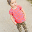 Stock Photo: Baby girl walking outdoors