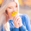 Attractive blonde girl with dandelions — Stock Photo