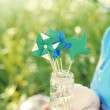 Paper pinwheels in glass jar — Stock Photo #34332045