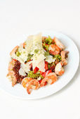Salad with cheese, shrimp, greens, tomatos, lettuce — Stock Photo