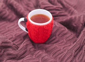 Knitting cup on brown cover — Stock Photo