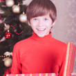 Happy kid boy opening christmas gift — Stock Photo #35558859