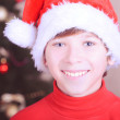 Smiling kid boy with christmas hat — Stok fotoğraf