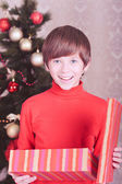 Happy kid boy opening christmas gift — Stock Photo