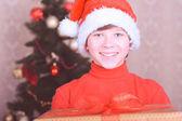Smiling child holding christmas presents — Stock Photo