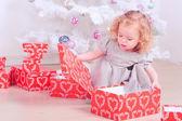 Girl holding christmas gift — Stock Photo