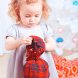 Girl opening gift — Stock Photo