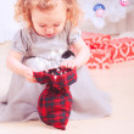 Girl opening gift — Stock Photo #36868187