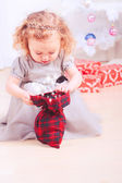 Girl opening gift — Stock Photo