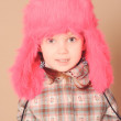Cute baby girl wearing fur hat in studio — Stock Photo #38252363