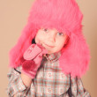 Cute little girl wearing fur hat in studio — Stock Photo