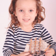 Cute little girl holding toy ship in studio — Stock Photo #38389149