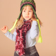Cute little girl wearing winter clothes — Stock Photo