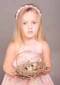 Girl holding nest with eggs — Stock Photo