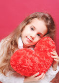 Cute girl holding valentine's heart — Stock Photo