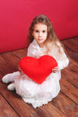Cute girl holding red valentine's heart — Stock Photo