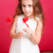 Cute little girl holding valentine's hearts — Stock Photo #40586301