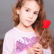 Stock Photo: Cute little girl holding valentine's heart