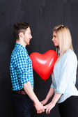 Couple with heart balloon — Stock Photo
