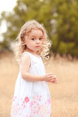 Girl walking in meadow — Stock Photo
