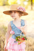 Girl holding basket with cherries — Stock Photo
