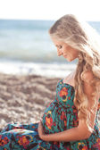 Pregnant woman at beach — Stock Photo