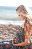 Pregnant woman at beach — Stock Photo