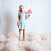 Girl holding candy — Stock Photo