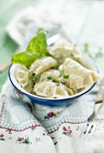 Dumplings with spinach and grits — Stock Photo