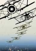 Old biplanes flying in the clouds, retro aviation background. — Stok Vektör