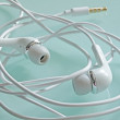 Wrapped earbud headphones — Stockfoto