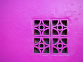 Pink concrete block on the wall — Stock Photo