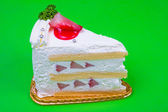 Strawberry cream cake in green background — Stock Photo