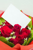 Red bouquet with card — Stock Photo