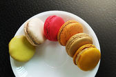 Colorful Macarons in the dish — Stock Photo
