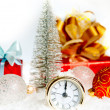 New Year's clock. Christmas clock and fir branches covered with snow — Stock Photo