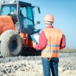 Engineer in a construction helmet. construction of a new road. worker. — Foto Stock