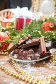 Chocolate with nuts and cinnamon on the holiday table. christmas decoration — Foto Stock