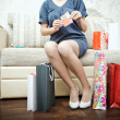 Girl with purchases. Woman with packages from the store. — Stock Photo