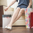 Stock Photo: Girl with purchases. Womwith packages from store.