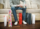 Man in shop with packages. — Stock Photo