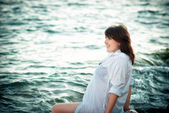 Pregnant woman on the sea. Water treatments for pregnant women — Stock Photo