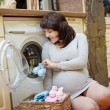 Stock Photo: Women wash clothes newborn