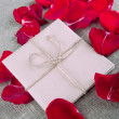Letter and rose petals — Stock Photo