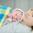 Little newborn baby in the arms of mother. — Stock Photo #39874045