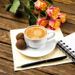 Cup of coffee on wooden table, chocolate truffle — Stock Photo #39874837