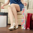 Girl with purchases. — Stock Photo