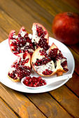 Pomegranate fruit on the table, — Stock Photo