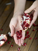 Pomegranate fruit on the table, sliced — Stock Photo