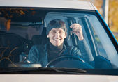 Man driving a new car — Stock Photo